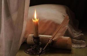 writing with quill parchment and candle